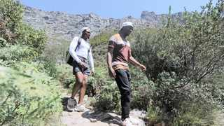 Zanozuko Booi (left) and Sabatha Matiwane, come down Table Mountain after hiking Platteklip Gorge. Table Mountain is still a hotspot for muggings and has seen several vicious attacks by criminals on tourists and outdoor enthusiasts. Photographer: Armand Hough/African News Agency(ANA)