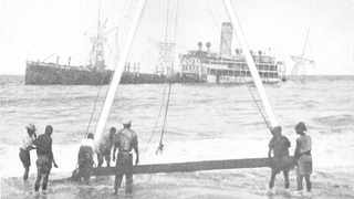 The Italian ship Timavo being salvaged after her captain ran her aground off Zululand in 1940 to avoid capture by Allied forces.