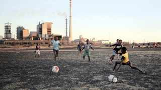Boys play soccer in Marikana's Nkaneng township. A study has debunked claims made about mining. Siphiwe Sibeko Reuters