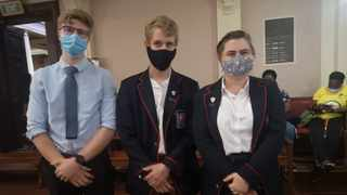 Three of the matrics in court, from left Christian Swanepoeol of Afrikaanse Hoër Seunskool, and Gerhard Burger and Lienke Spies of Dirk Postma High School. Picture: Zelda Venter