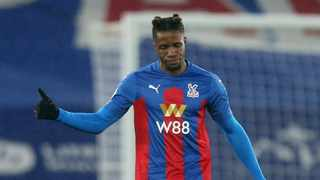 Crystal Palace forward Wilfried Zaha says he is going to stop taking a knee before Premier League matches and instead wants to see concrete action to tackle racism. Photo: Steven Paston/Reuters