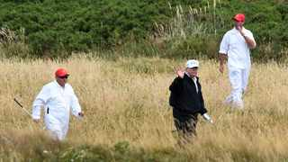 As much as President Donald Trump loves golf, leaders of the sport are racing away from the embattled US leader for what they say is the good of the game. Photo: AFP
