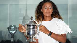 CHAMP: Naomi Osaka of Japan poses with the championship trophy at the Top of the Rock Observatory the day after winning the Women's Singles finals match against Serena Williams at the 2018 US Open. Photo: Caitlin Ochs/ Reuters