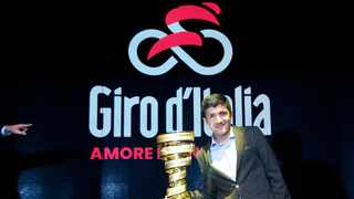 Ecuadorian rider Richard Carapaz poses with the 103rd cycling tour of Italy's trophy during the official presentation in Milan, northern Italy. Photo: Matteo Bazzi/ANSA via AP