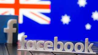 A 3D printed Facebook logo is seen in front of displayed Australia's flag in this illustration. File picture: Reuters/Dado Ruvic
