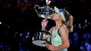 Sofia Kenin of the US kisses the Daphne Akhurst Memorial Cup after defeating Spain's Garbine Muguruza in the women's singles final at the Australian Open tennis championship in Melbourne earlier this year. Photo: Lee Jin-man/AP