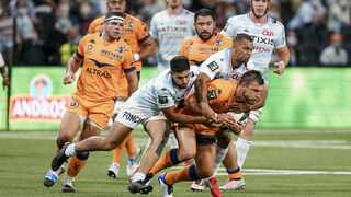 Racing 92 Kurtly Beale and Donovan Taofifenua tackle Montpellier's Handre Pollard during a French Top 14 match. Picture: Julien Poupart/ABACAPRESS.COM via Reuters