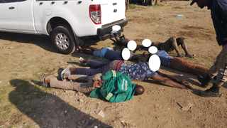 Eight men from Mozambique and Zimbabwe have been arrested after they were found in possession of a hijacked truck and stolen trailer. Picture: EMPD.