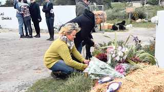 Friends and family lay flowers and wreaths for Meghan. Picture: Supplied