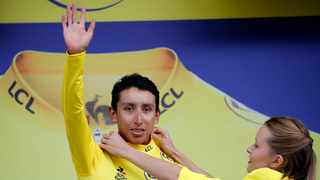 New overall leader Colombia's Egan Arley Bernal Gomez wearing the yellow jersey celebrates on the podium. Tour de France organizers stopped Stage 19 of the race because of a hail storm as Julien Alaphilippe lost his yellow jersey to Egan Bernal. Photo: Christophe Ena/AP Photo