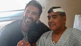 Argentine football legend Diego Maradona poses for pictures with his doctor Leopoldo Luque. Luque is being investigated for involuntary manslaughter following the football legend's death. Picture: Diego Maradona press office/AFP