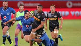 Juarno Augustus of the Stormers is tackled by Nizaam Carr of the Bulls during their Preparation Series match at Loftus Versfeld Stadium in Tshwane on Friday. Photo: Samuel Shivambu/BackpagePix