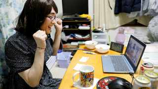 A male crossdresser who goes by the pseudonym Anzu reacts as he hosts an online nomikai. Picture: Reuters/Kim Kyung-Hoon