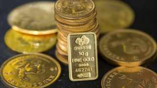 FILE PHOTO: Gold bullion is displayed at Hatton Garden Metals precious metal dealers in London