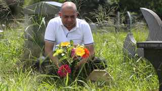 Degino Govender at his parents recycled gravesite at the Mobeni Heights Cemetery. Picture: Zanele Zulu/African News Agency/ANA