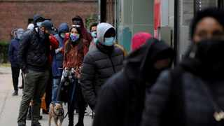 Congresswoman Alexandria Ocasio-Cortez stands in line with her partner Riley Roberts and her French Bulldog, Deco, as she waits to vote early at a polling station in The Bronx, New York City. Picture: Andrew Kelly/Reuters