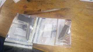 The firearm and bloodied knife. Picture: SAPS