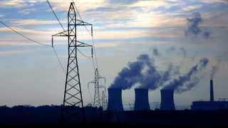 In this file picture, an Eskom coal-fired power station belches smoke as the sun rises. Picture: EPA