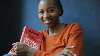 Author Jackie Phamotse with her book, Bare: The Cradle of The Hockey Club. Karen Sandison/African News Agency (ANA) Archives
