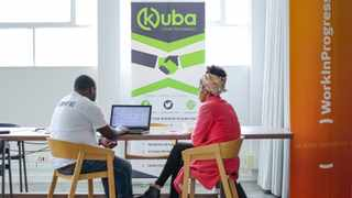 Kuba MD Jacques Sibomana sits with one of 50 entrepreneurs signed onto a new Job Booster programme. Photography credit: SudijonsGraphs