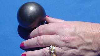 A single person can hold in his two hands enough PMBR fuel balls to provide the total electricity for his entire lifetime. Photo: Supplied