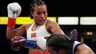 Norwegian boxing trailblazer Cecilia Braekhus suffered the first defeat of her professional career on Saturday, losing her WBA, WBC, IBF and WBO welterweight titles in a majority decision loss to underdog Jessica McCaskill (not pictured). Picture: Chris Carlson/AP