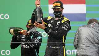 Daniel Ricciardo celebrates on the podium after finishing third. Picture: Wolfgang Rattay / Reuters.