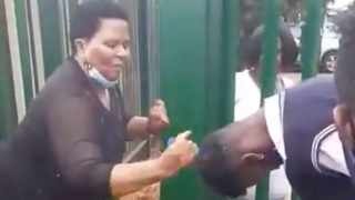 A VIDEO of a school teacher ferociously combing schoolboys' hair at a school has gone viral. Picture: Twitter