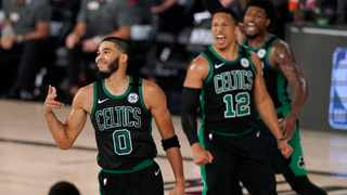 Boston Celtics' Jayson Tatum celebrates after sinking a 3-point basket, as Grant Williams and Marcus Smart cheer him on in during their NBA game against the Toronto Raptors. Picture: Mark J. Terrill/AP
