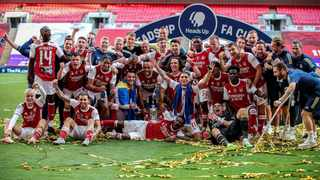 Arsenal players celebrate with the FA Cup after beating Chelsea in the final at Wembley in August this year. Photo: Adam Davy/EPA