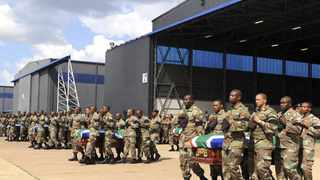 "Members of the South Africa National Defence Force (SANDF) carry the mortal remains of 13 members that were killed in Central African Republic (CAR) during the handing over to the respective families at the Waterkloof Air Force Base, in Pretoria, March 28, 2013. South African soldiers gathered in Uganda on Thursday for a ""new mission"" to the CAR, where 13 of their comrades were killed in a rebel coup at the weekend, South African media and a senior Ugandan officer said. REUTERS/Stringer (SOUTH AFRICA - Tags: MILITARY POLITICS OBITUARY)"