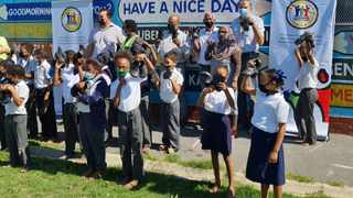 From left: Chairperson of subcouncil Angus Mackenzie, Speaker Masizole Mnqasela , Principal Abrahams , Community leader John Siljeur, Councillor Asa Abrahams and PR Abraham Griesel with learners from Bergville Primary School.