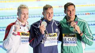 Bronze medallist Chad le Clos of South Africa, right, with Caeleb Dressel of the US and Andrei Minakov of Russia. Photo: Reuters