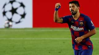 FILE - Atletico Madrid have completed the signing of Luis Suarez from Barcelona. Photo: Albert Gea/Reuters
