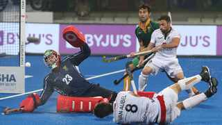SA goalkeeper Rassie Pieterse (left) in action against Belgium's Florent Van Aubel (right, down) during the men's Field Hockey World Cup match between Belgium and South Africa at the Kalinga Stadium in Bhubaneswar, India in December. Photo: EPA/Harish Tyagi