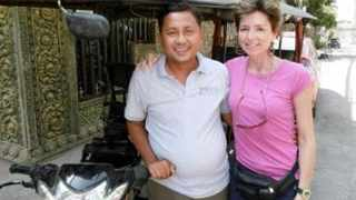 Former South African journalist at The Star newspaper Gabrielle Yetter with her tuk-tuk driver, Som-On, who features in her book.