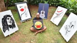 Self-taught artist Gontse Maloka who started practising art during Covid-19 poses with her artwork in Montana. Picture: Thobile Mathonsi African News Agency (ANA)