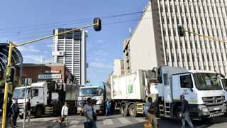 05/06/2014. Waste Management workers blocked off the street leading to the Tshwane municality offices in the city demanding the monies that they claimed are owed to them. Picture: Masi Losi