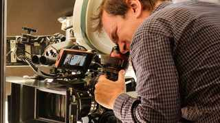 """This image released by Sony Pictures shows director Quentin Tarantino during the filming of """"Once Upon a Time in Hollywood."""" Picture: Andrew Cooper/Sony via AP"""