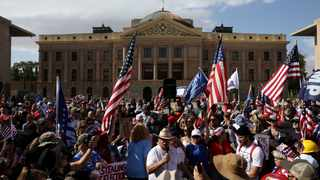 Supporters of US President Donald Trump gather at a 'Stop the Steal' protest in front of the Arizona State Capitol in Phoenix after the 2020 US presidential election was called for Democratic candidate Joe Biden. File picture: Jim Urquhart/Reuters