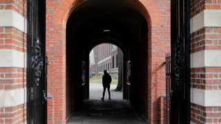 A man walks through a gate to the Yard at Harvard University in Cambridge, Massachusetts. File picture: Brian Snyder/Reuters