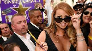 Mariah Carey is surrounded by fans during a ceremony honouring Carey with a star on the Hollywood Walk of Fame on August 5, 2015 in Los Angeles.