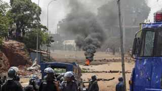 Anti-riot police clash with opposition protesters in Conakry.