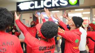 EFF members outside the Clicks store in Goodwood Mall on Monday morning. More than 400 stores across SA were closed due to protests over a hair advert gone horribly wrong. Picture: Henk Kruger/African News Agency (ANA)