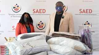 Tefo Maloka of the Tshwane University of Technology hands over blankets and other essentials to Dr Dudzai Nyamutinga of Youth For Survival Centre. Picture: Thobile Mathonsi/African News Agency (ANA)
