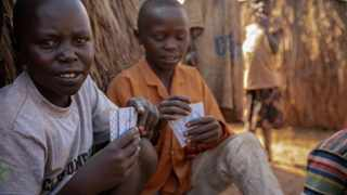 Children sit and play cards in Linzi displacement camp in Ituri Province, Democratic Republic of Congo, in February 2020. Picture: Unicef