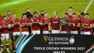 Wales' Alun Wyn Jones celebrates with the trophy after winning the triple crown with teammates. Photo: Rebecca Naden/Reuters
