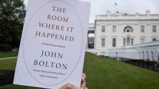 "A copy of ""The Room Where It Happened,"" by former national security adviser John Bolton, is photographed at the White House in Washington. Picture: Alex Brandon/AP"
