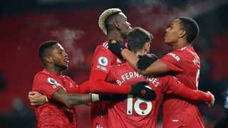 Manchester United closed in on the Premier League's pole position after a 2-1 home win over Aston Villa on Friday put them level on points and games played with champions and leaders Liverpool. Photo: Carl Recine/AFP