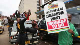 Marchers make a point as euphoric crowds march on the streets Saturday, Nov. 18, 2017, in Harare, Zimbabwe, demanding the departure of President Robert Mugabe. Picture: AP Photo/Tsvangirayi Mukwazhi